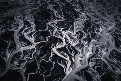 Swirling glacial rivers - Iceland - Copyright 2018 Albert Dros